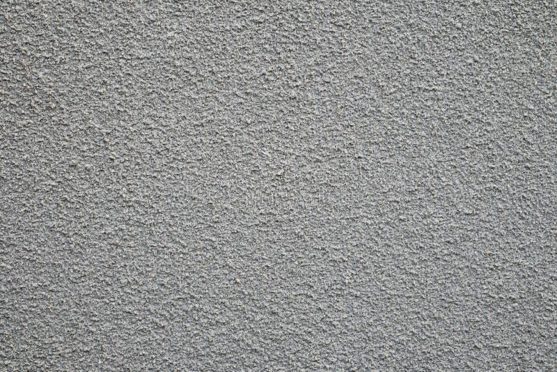 Masern Sie Hintergrund, Sandexplosionsbetonmauer-Beschaffenheitshintergrund stockbilder