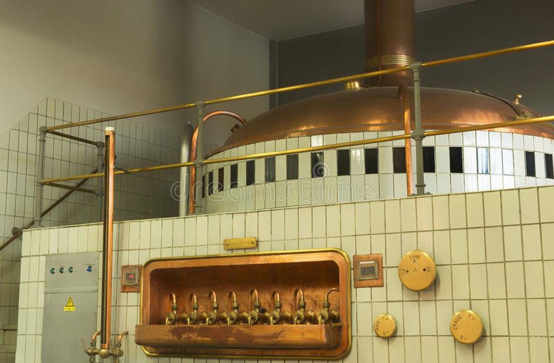 Mash tun and wort siphoning valves in brewery. stock images