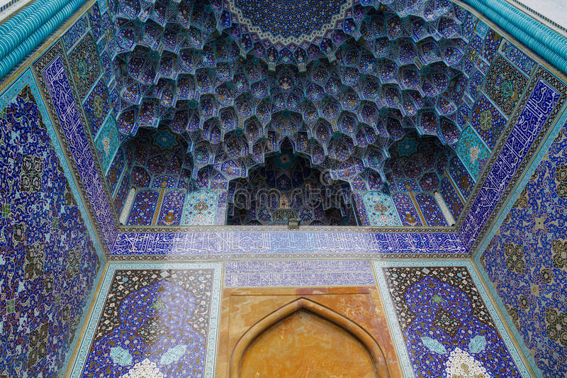 Mashed-e Emam. Intricate blue tiles adorn the walls of a large Iranian mosque and mirror a clear sky that beckons the faithful to the sunny courtyard, exquisite royalty free stock photos