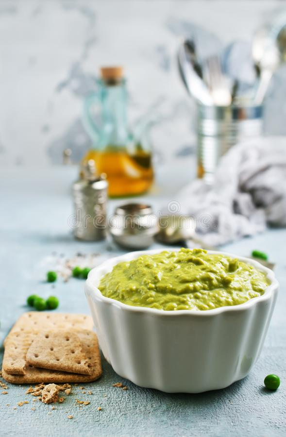 Mashed green peas stock photography