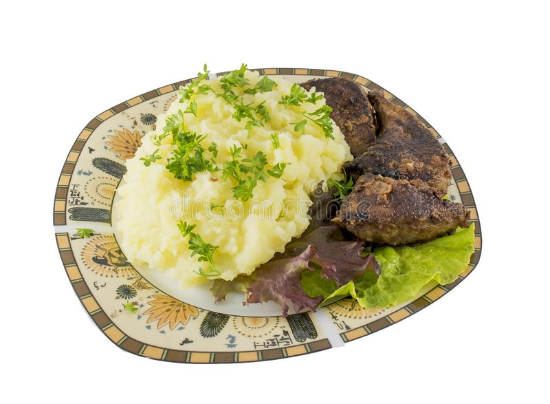 Mashed potato with fried liver and green salad isolated stock photography