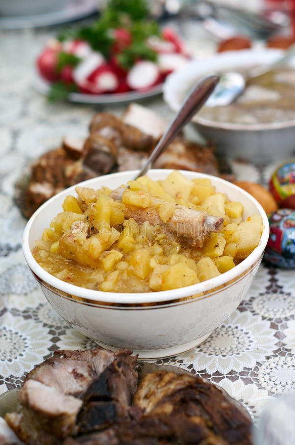 Mashed Potato with fried Onions and loin ribs in a small bowl. Vertical, selective focus shot of an assortment of meals. Mashed Potato with pork ribs in bowl stock photography