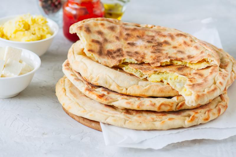 Mashed potato and sheep cheese filling flatbread on a white stone background. royalty free stock photos