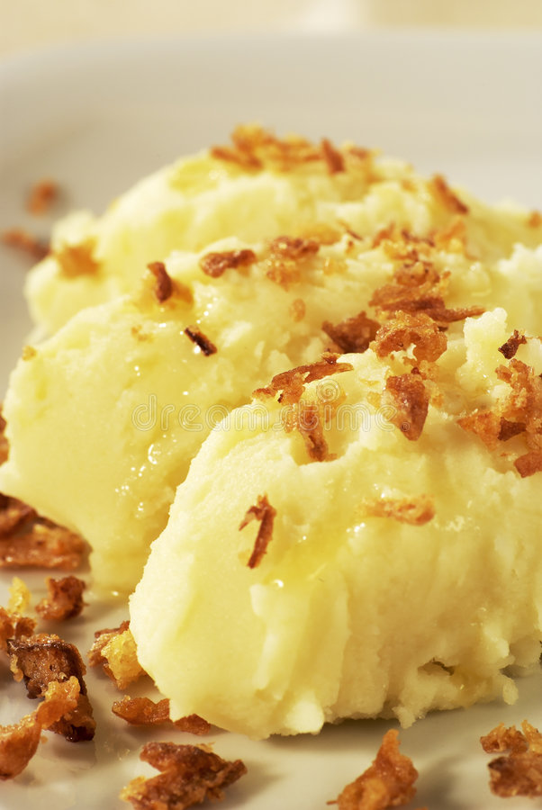 Mashed potato topped with browned onion stock image