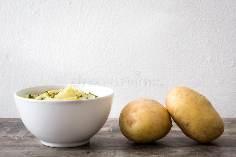 Mashed potato on a wooden table stock image