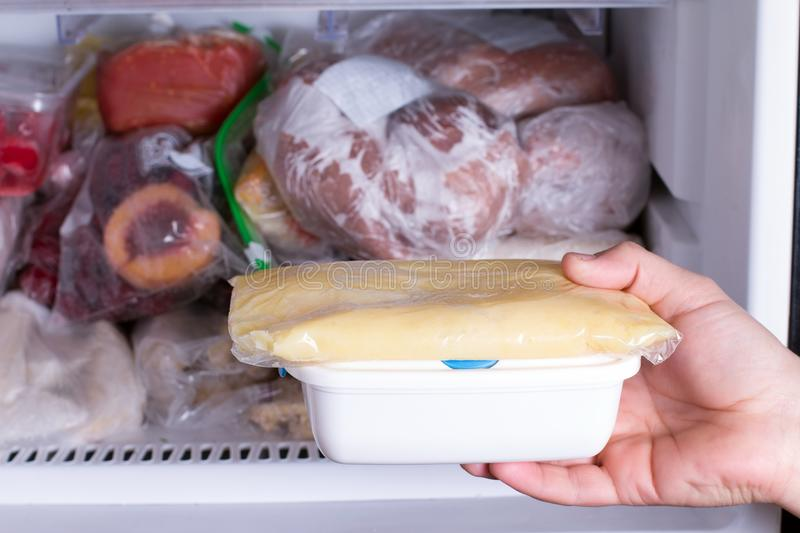 Mashed potatoes in a container in the freezer. Frozen food royalty free stock photos