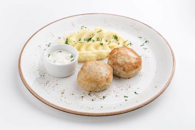 Mashed potatoes and meat balls with white sauce isolated on white background stock photo