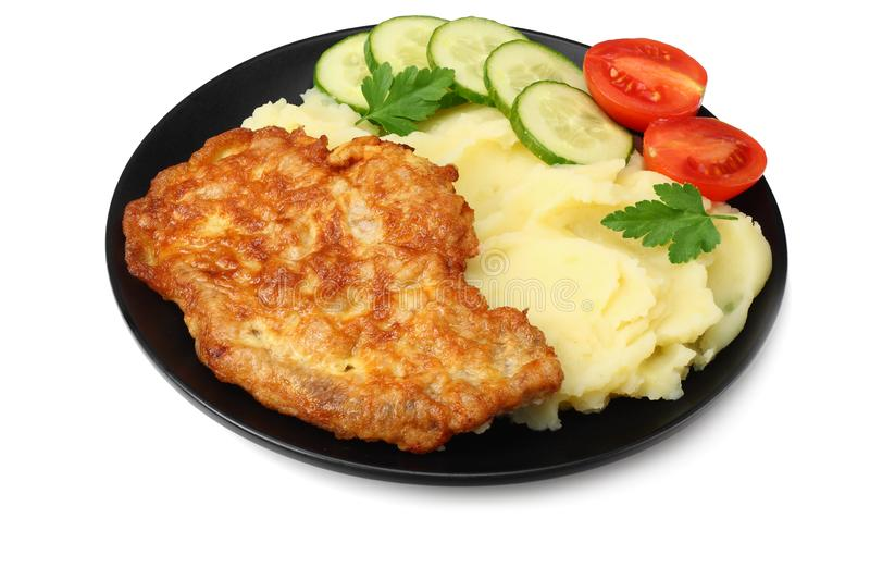 Mashed potatoes with schnitzel on black plate isolated on white background stock image