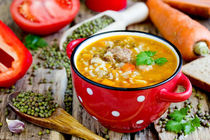 Mashhurda - traditional uzbek meat soup with rice, mung beans and vegetables. Close up royalty free stock photo