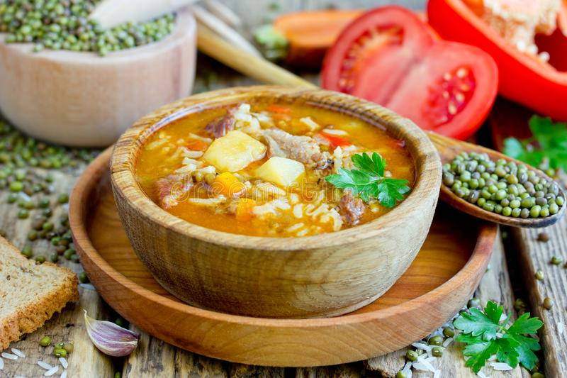 Mashhurda - traditional uzbek meat soup with rice, mung beans and vegetables. Close up stock photos