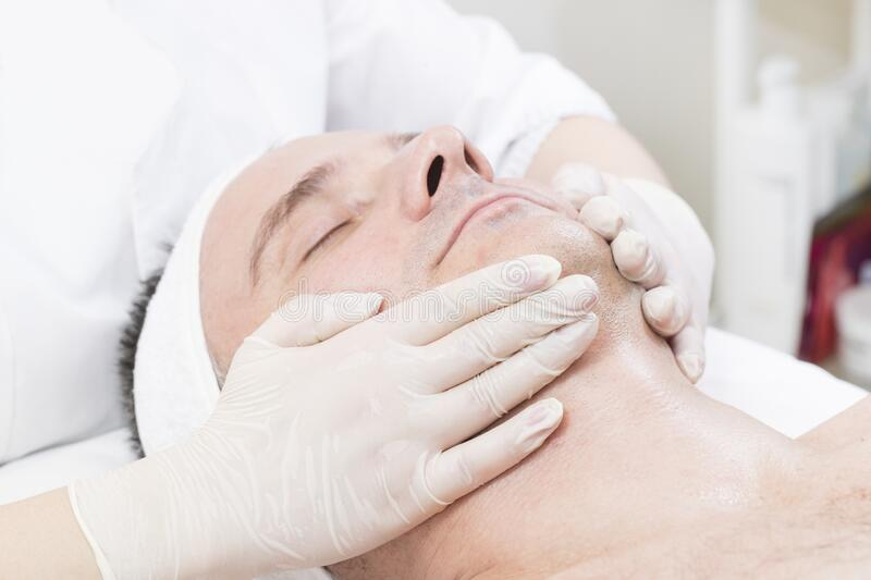 Mask cosmetic procedure in spa salon stock photography