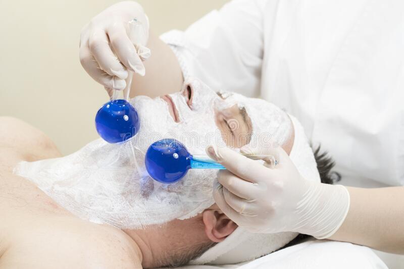 Mask cosmetic procedure in spa salon royalty free stock photo