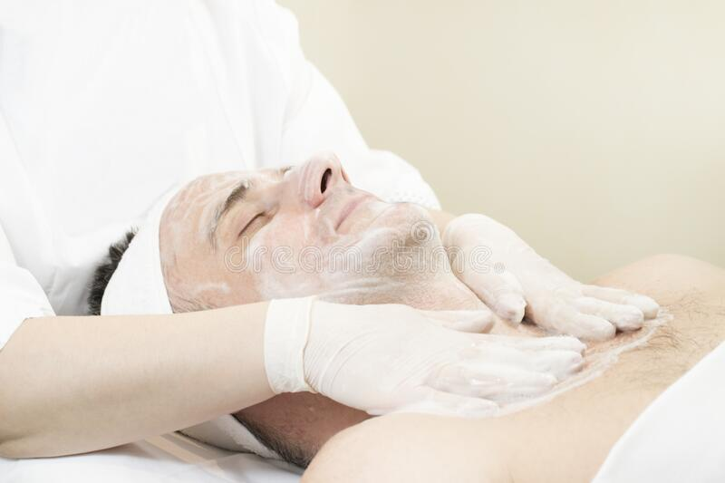 Mask cosmetic procedure in spa salon stock images