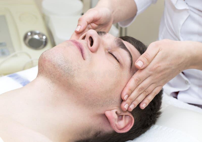 Mask cosmetic procedure in spa salon. Man in the mask cosmetic procedure in spa salon stock image
