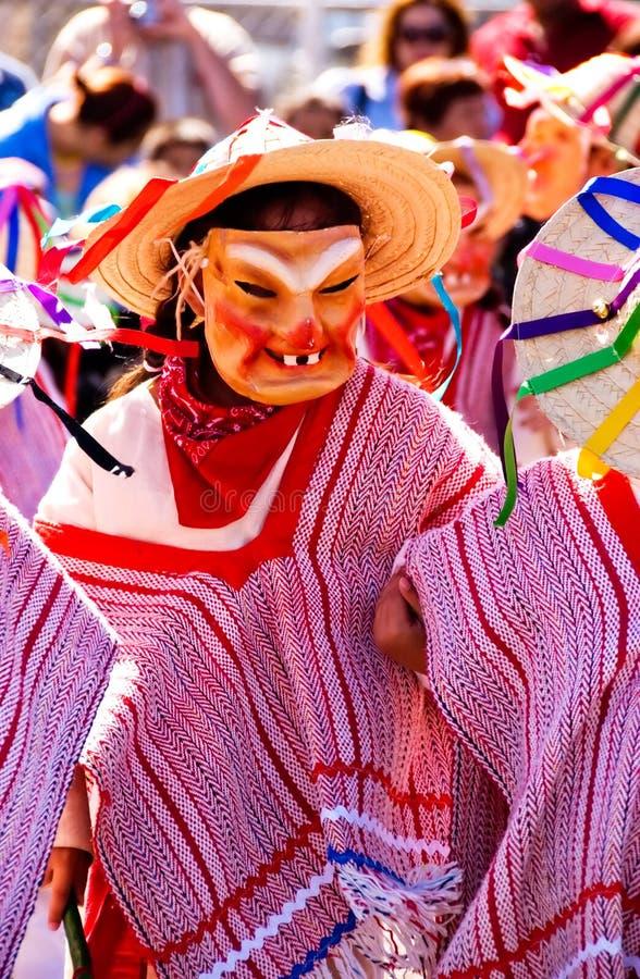 Mask dance under the sun stock photo
