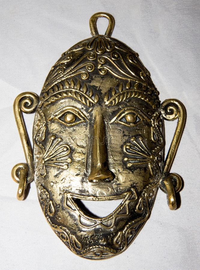 Mask made of brass metal handcrafted. Traditional tribal mask of brass metal created by handicraft artist. These kinds of mask mostly used by tribal people of royalty free stock photography
