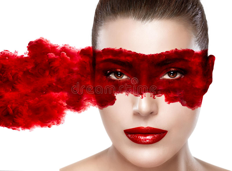 The Mask. Mysterious Girl. Beautiful face woman with smoke eye mask. Closeup portrait isolated on white royalty free stock image
