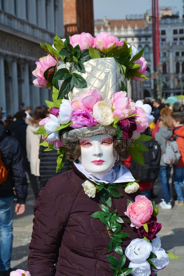 Mask and pink flowers, Venice, Italy, Europe stock photos
