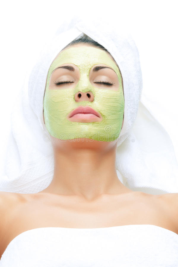 Mask. Portrait of young beautiful woman being treated stock photos