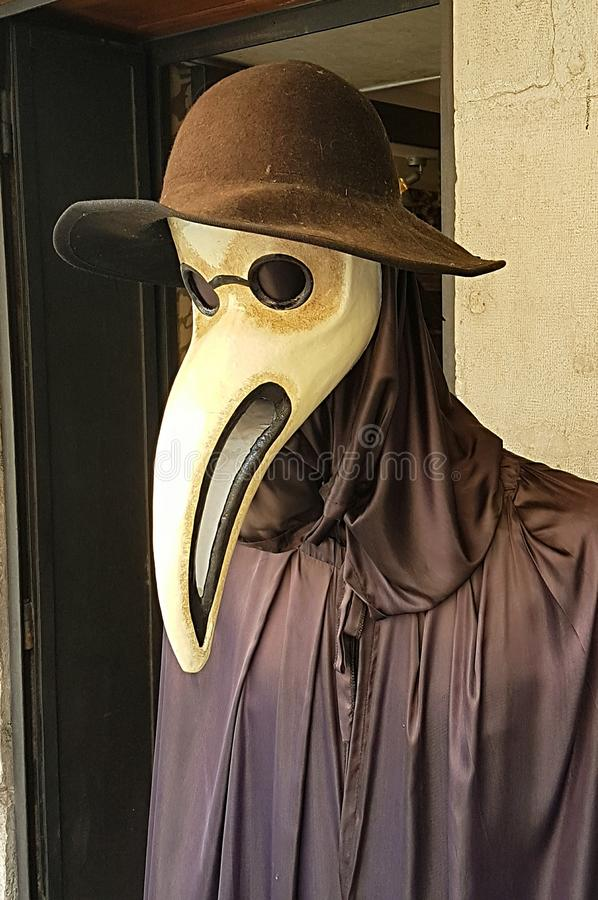 Plague doctor mask. A mask and robe for a plague doctor's outfit in Venice stock photography