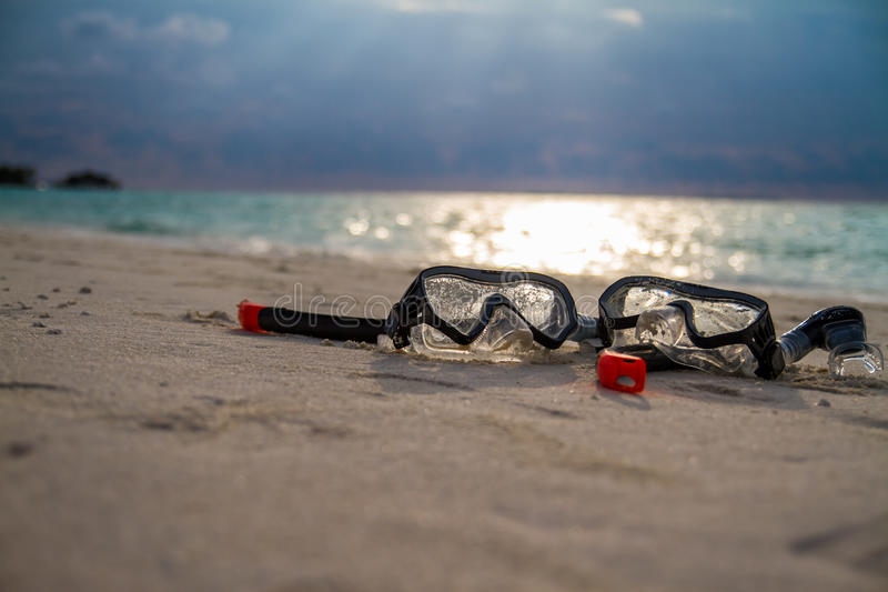 Mask and snorkel on the white sand in a tropical beach royalty free stock photography