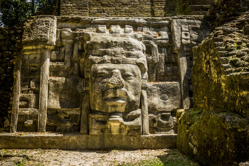 Mask Temple, Lamanai Ruins. Left mask of the Mask Temple at the Lamanai Ruins in Belize stock images