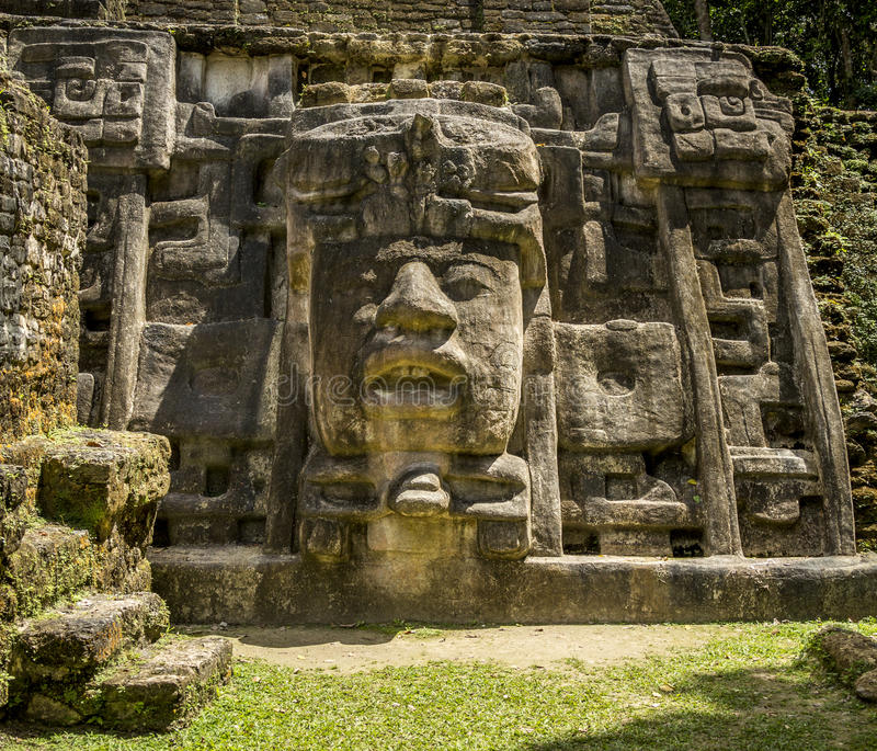Mask Temple, Lamanai Ruins. Right mask of the Mask Temple at the Lamanai Ruins in Belize stock image