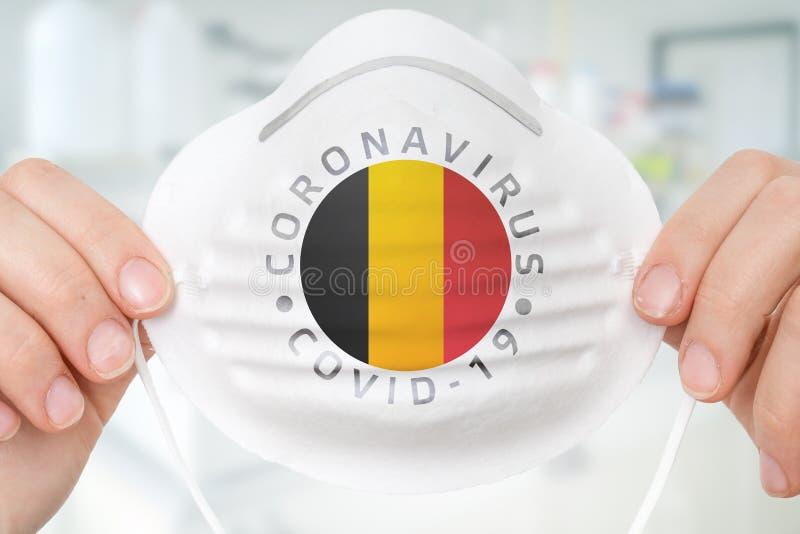 Maska oddechowa z flagą Belgii - Coronavirus COVID-19 conc fotografia royalty free