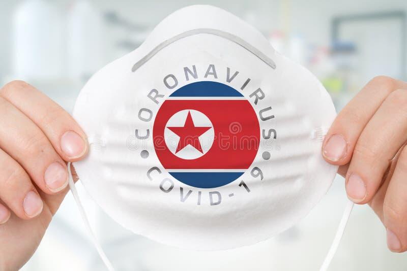 Maska oddechowa z flagą Korei Północnej - Coronavirus COVID-19 zdjęcie royalty free