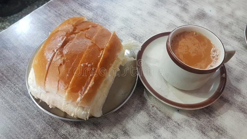 Maska Pav and Chai. A famous combo called Chaai and Maska Pav which is Indian tea with bread butter. This combo is served in many hotels all over India and is stock photo