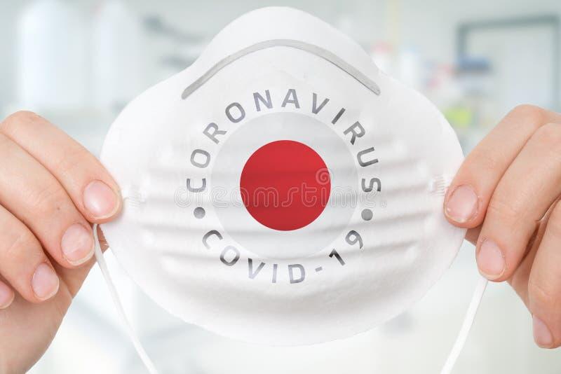 Maska respiratora z flagą Japonii - Coronavirus COVID-19 concep zdjęcie stock