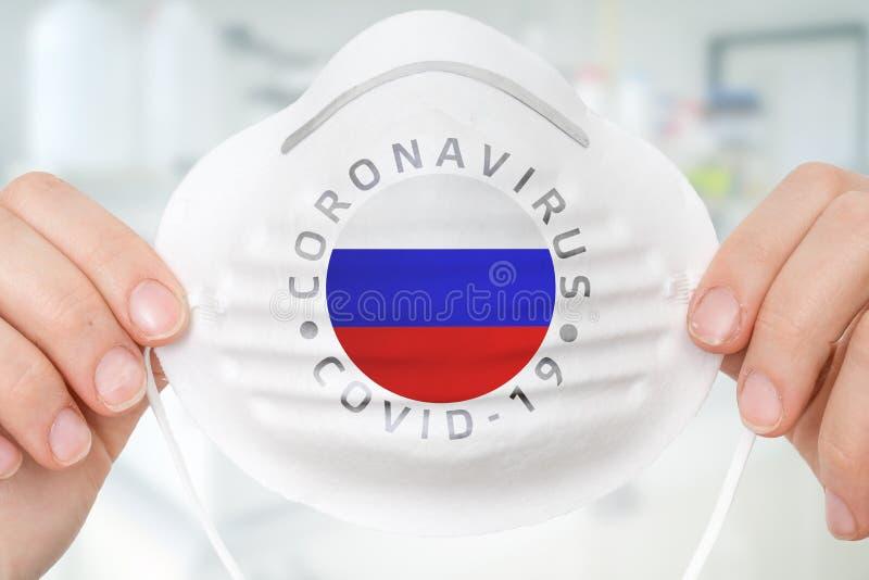 Maska respiratora z flagą Rosji - Coronavirus COVID-19 conce fotografia royalty free