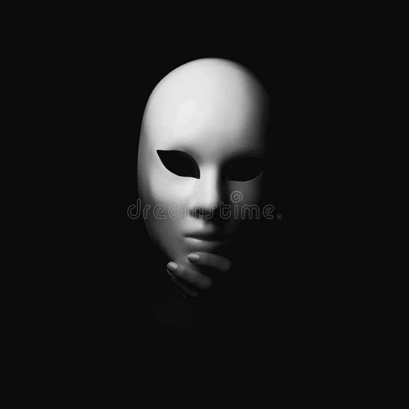 Maske in der Hand Halloween stockbild