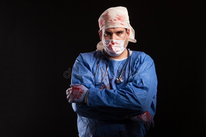 Masked crazy doctor for halloween isolated over black background. Doctor with crazy mental disorder royalty free stock photos