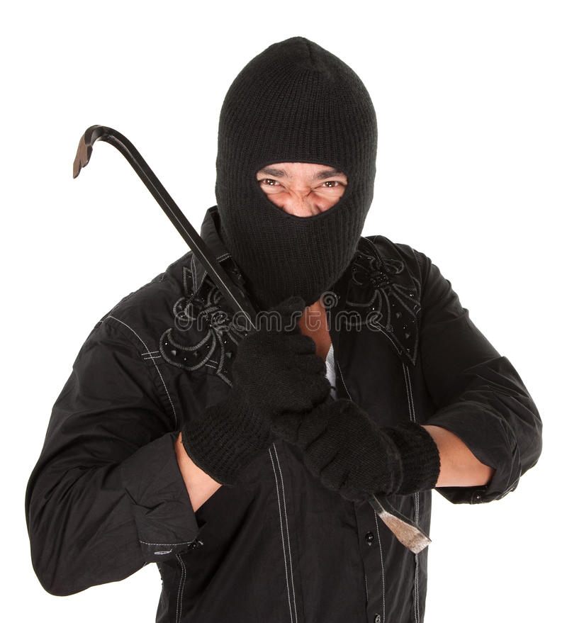 Masked Criminal. Holding a crowbar on white background royalty free stock photography