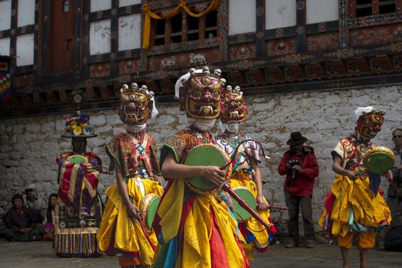Masked dance , dancers with terrifing masks and drums , Prakar Lhakhang , Bumthang , central Bhutan stock photo