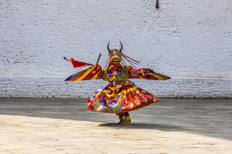 Masked dancer. S at drupchen festival in the dzong of Punakha, Bhutan. Drupchen festival is taking place yearly in march royalty free stock photo