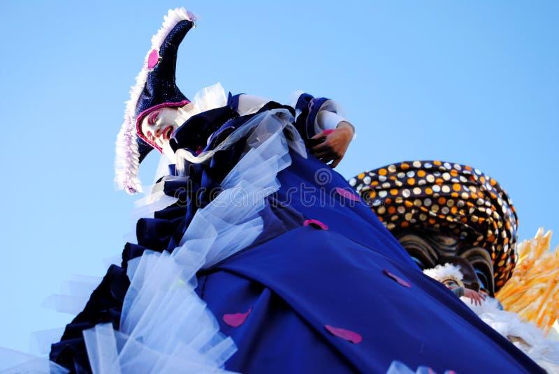 Masked dancers on Carnival float royalty free stock images