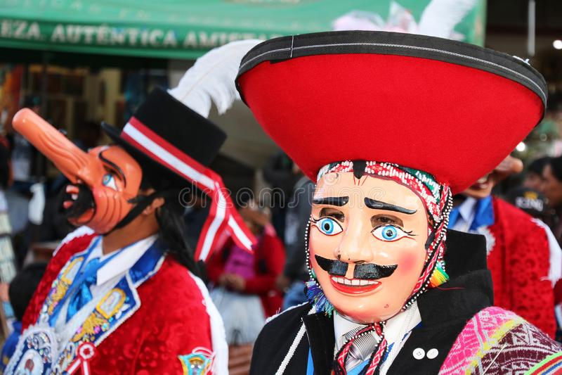 Peruvian fiesta. Masked dancers at a traditional Peruvian fiesta, celebrating the Virgen of Carmen in Pisac, in the Sacred Valley near Cusco stock photo