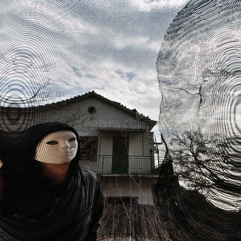 Masked Evil Figure Behind Threaded Window Stock Images
