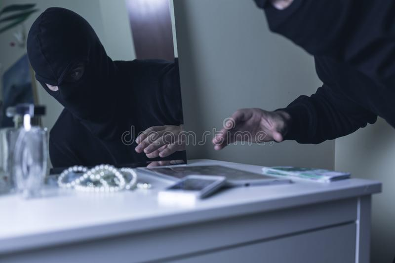 Masked intruder during robbery. Photo of masked intruder during robbery in villa royalty free stock photography