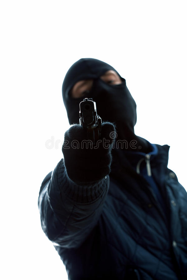 Masked man with gun. A masked man holding a gun aimed at us stock photos