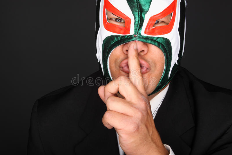 Masked man in a suit stock images