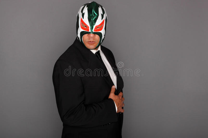 Masked man in a suit royalty free stock photography
