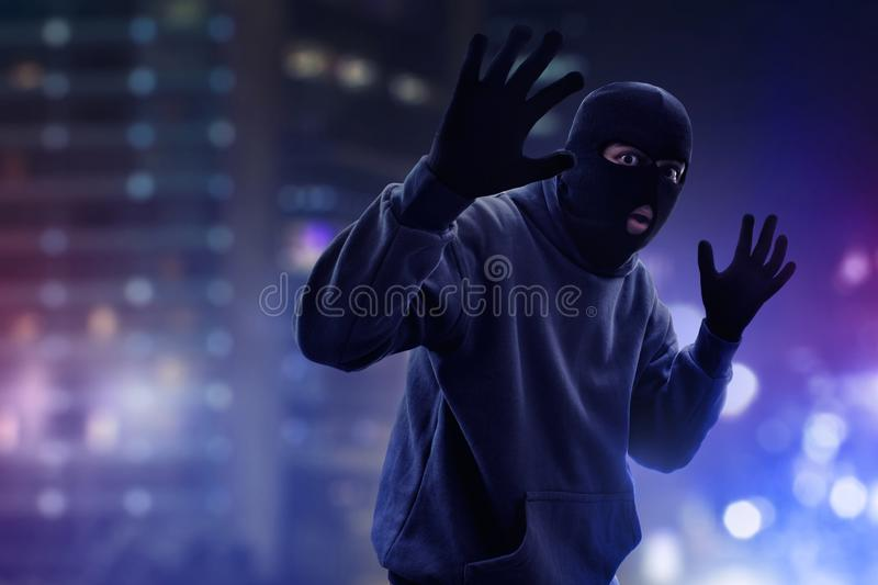 Masked thief caught by police. Masked thief caught at night royalty free stock images
