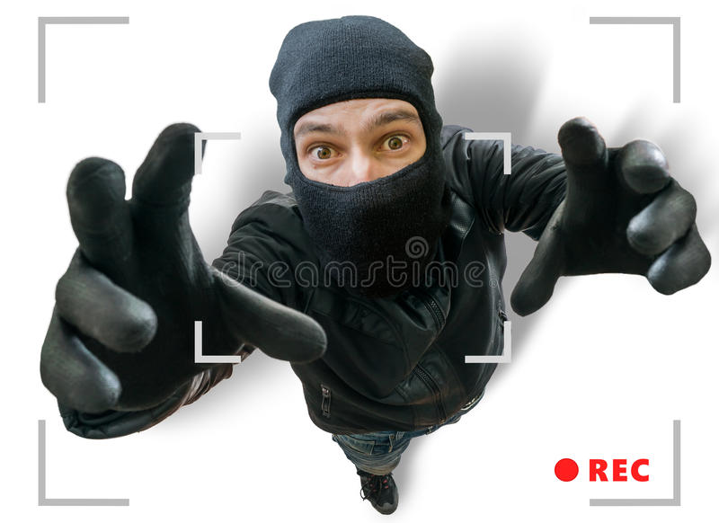 Masked thief or robber is recorded with security hidden camera.  royalty free stock image