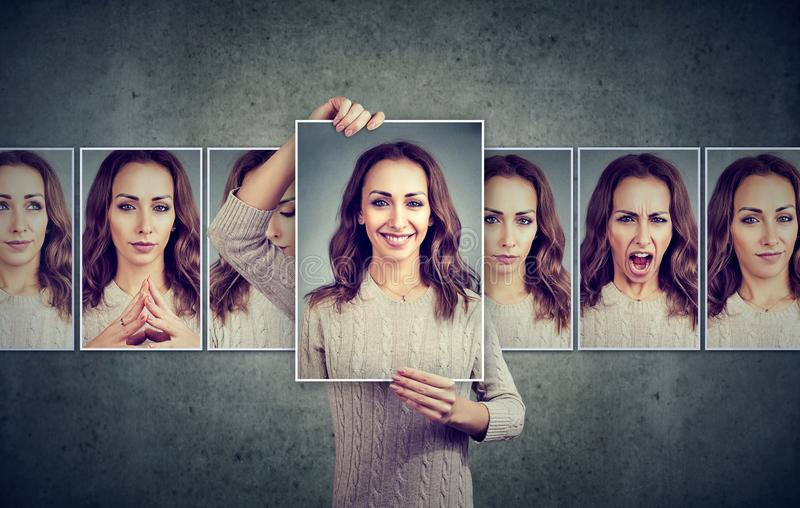 Masked young woman expressing different emotions. Masked woman expressing different emotions and face expression on gray background royalty free stock photos