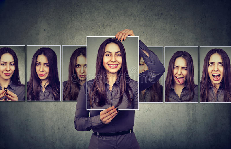 Masked woman expressing different emotions. Masked young woman expressing different emotions royalty free stock images