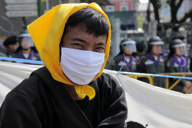 Masked Yellow-Shirt Protester Editorial Stock Image