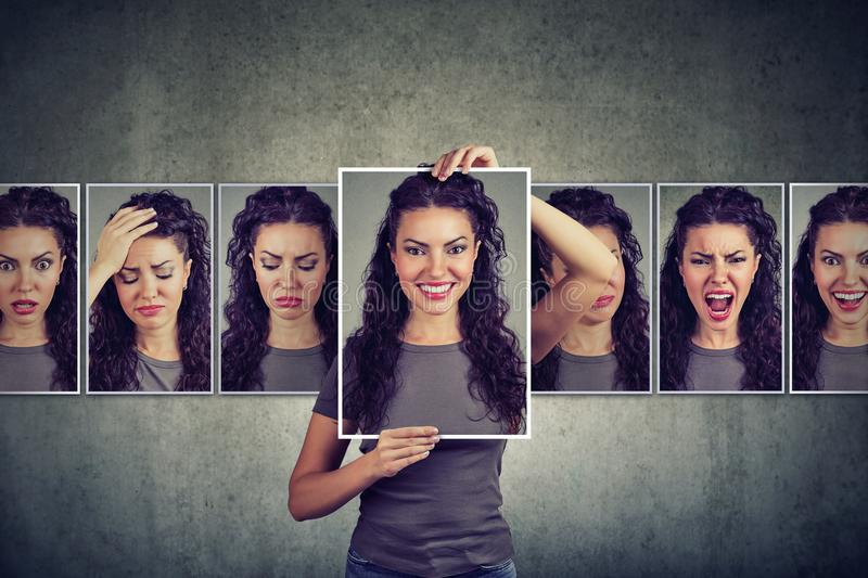 Masked woman expressing different emotions. Masked young woman expressing different emotions on gray wall background stock photo
